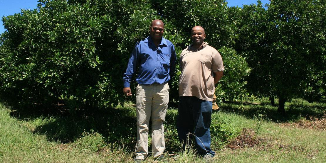 From left to right: Extension Officer, Melton Mulaudzi, with Siseko Maqoma